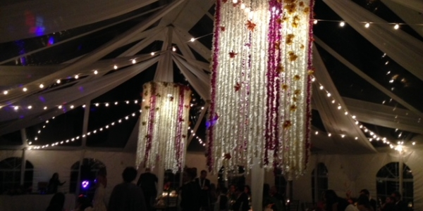 Fresh Garlands of Colorful Orchid Chandeliers Create a Dramatic Vibe