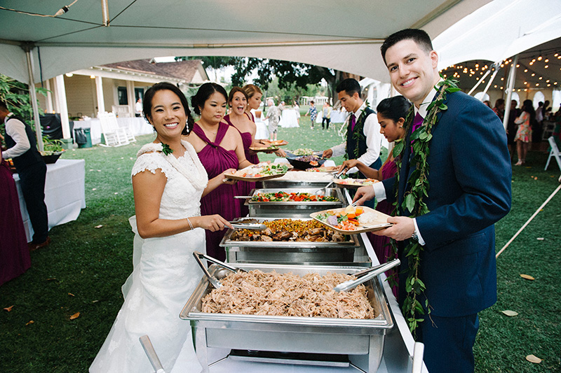 Guests Enjoying the Most Mouth-Watering Hawaiian Buffet of Kalua Pig, Lomi Lomi, Pulehu Chicken and More!