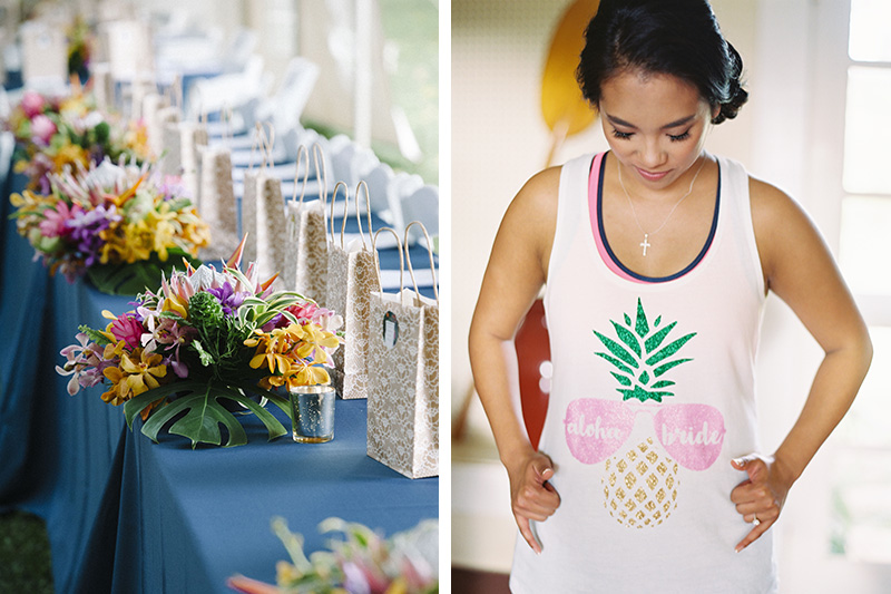 "Mounds of Bright Tropical Flower Centerpieces Line A Long Blue Table For The Bridal Entourage.  Our Bride, Jamie Looking Cool and Calm, Wearing A ""Aloha Bride"" Tee"