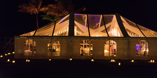 Lantern Lights and Airy Cafe Lights Create a Soft, Romantic Glow In and Around A Clear Top Tent