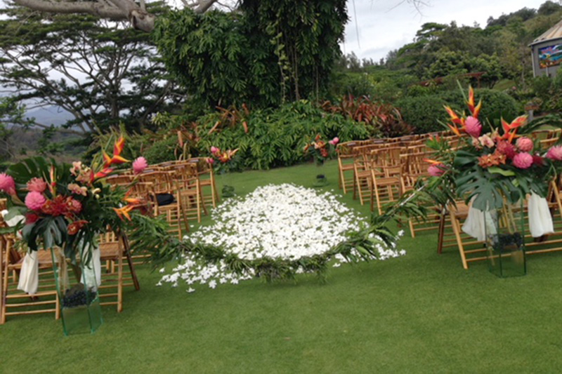 Exotic Tropical Flowers Adorn Wedding Aisle Flanked By Bamboo Chairs