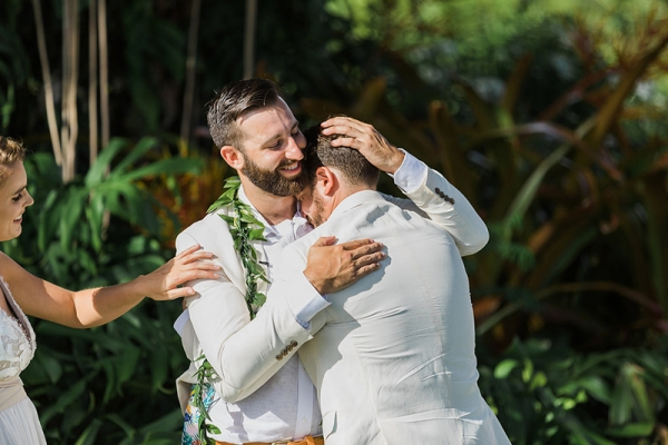 Weddings Are Full of Love and Emotion!   A Groomsman is Overcome With Joy as He Embraces the Groom