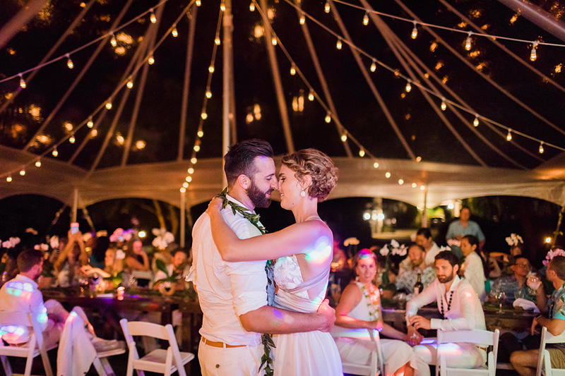 Tender Moment for the Bride and Groom During Their First Dance As Soft Romantic Lights Glow Above