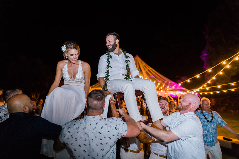 Celebrating A Family Tradition - the Horah.  The Bride and Groom Are Lifted in Chairs, and Guests Gather and Dance in Circles Around Them.