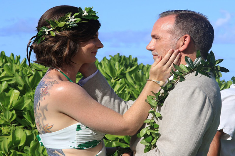 "Bride and Groom Tenderly Places Hand on Each Other,  Before Saying ""I Do"" in Kauai, Hawaii"