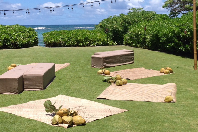 Kauai Style Outdoor Lounge Area with Lauhala Mats, Coconuts and Comfortable Benches