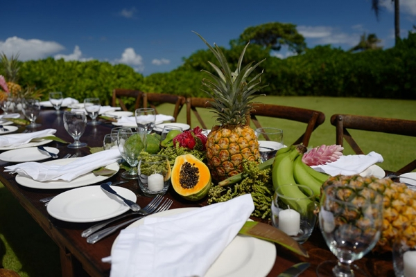 Tablescape of Fresh Pineapple, Papaya, Banana and Foraged Greens