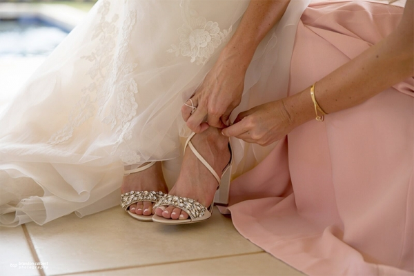 Mom Helping Bride Strap into Jewel Crusted Sandals for Her Wedding
